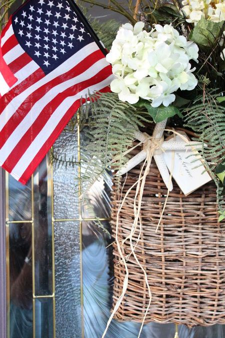 American flag in a basket of flowers, ivy, and ferns. (Photo: Starfish Cottage)