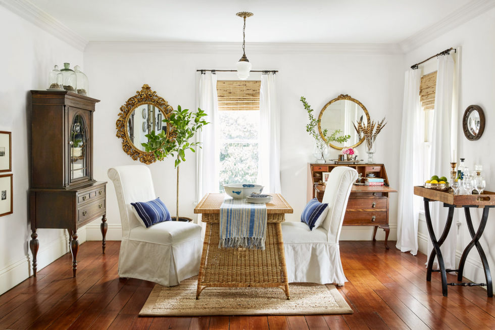 Dining room is bright and airy with an antique wicker desk for day-to-day dining needs.
