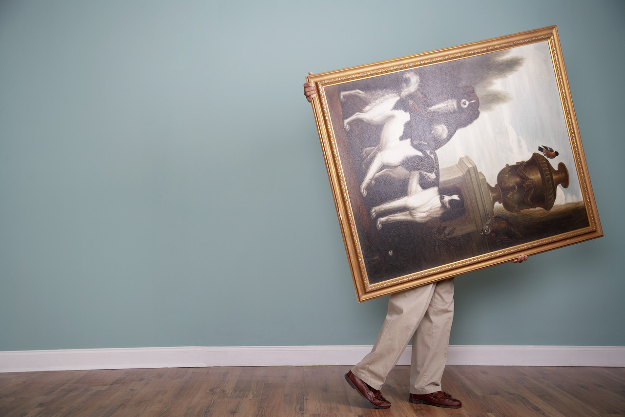 Man moving a painting