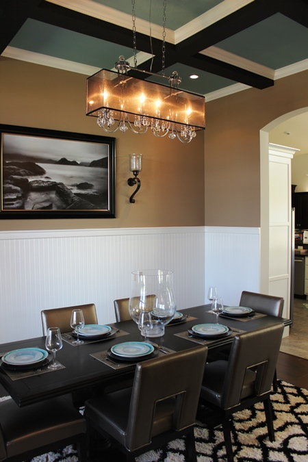 Dining room with beadboard and coffered ceiling