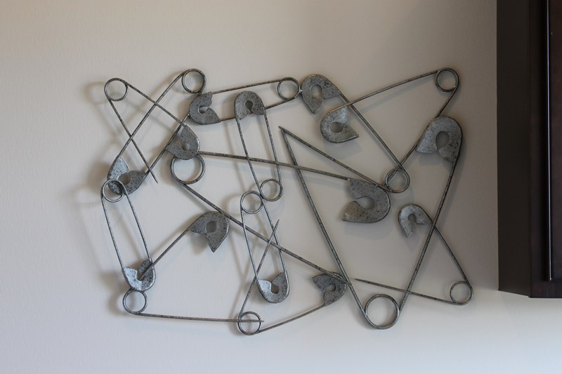Safety pin sculpture in laundry room
