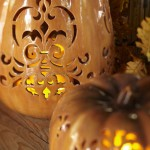 Punched Ceramic Pumpkin Luminary. (Photo: Pottery Barn)