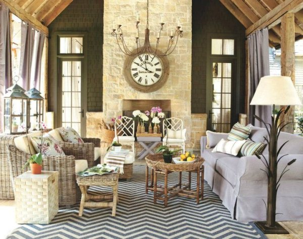 Trust the color wheel—opposing colors are always complimentary like yellow and purple. In this casual living room, a pale lavender sofa works well with the golden stonework, wicker furniture, and blue-grey chevron area rug. (Photo: Ballard Designs)