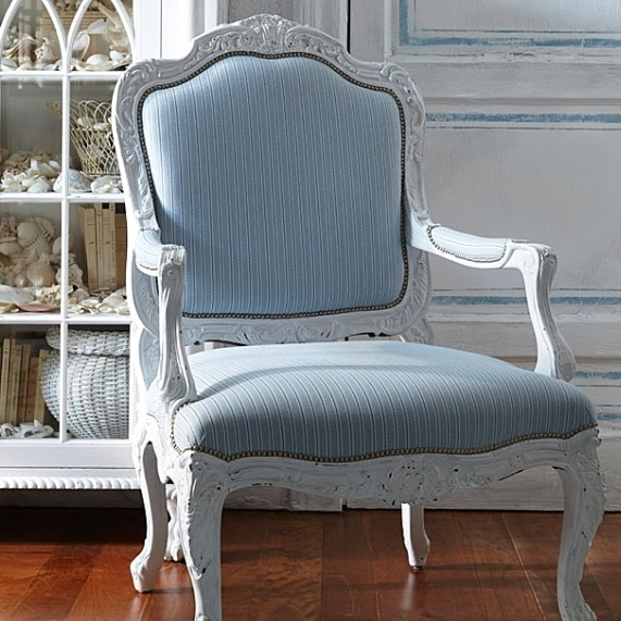 Ralph Lauren's Indian Cove Lodge Fauteuil in a distressed white finish with Maude Stripe-Fog fabric and nail head trim.