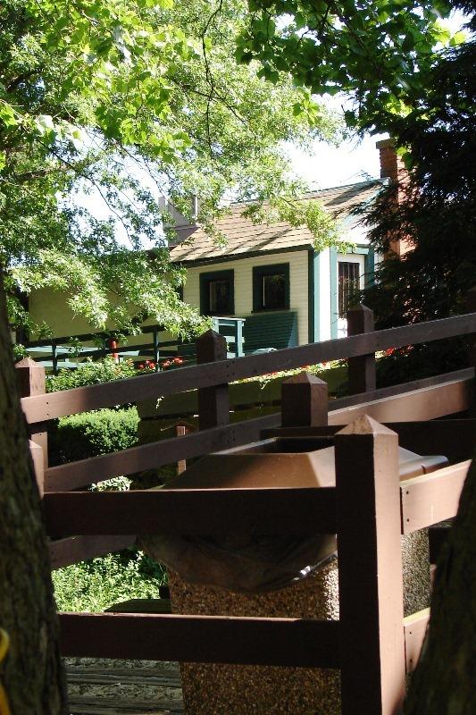 Ernest Warther's original workshop framed between the trees.