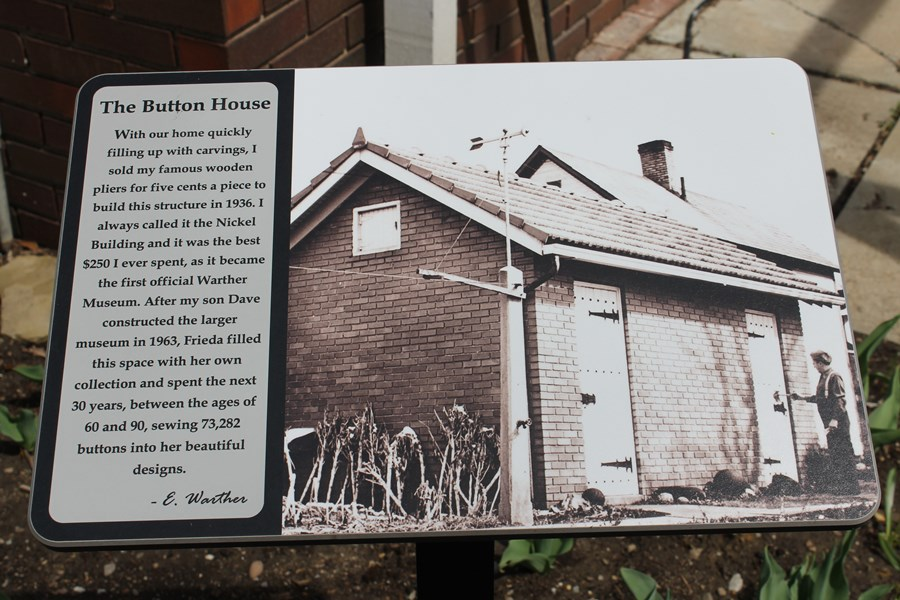 Sign at the Button House tells how, when, and why it was built.