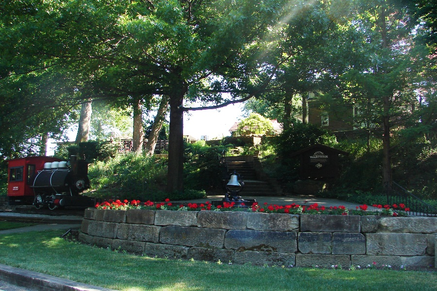 The grassy lower level where Warther built the playground for this children was once an old millstream.