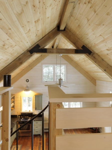 High, natural pine ceiling with exposed beams.