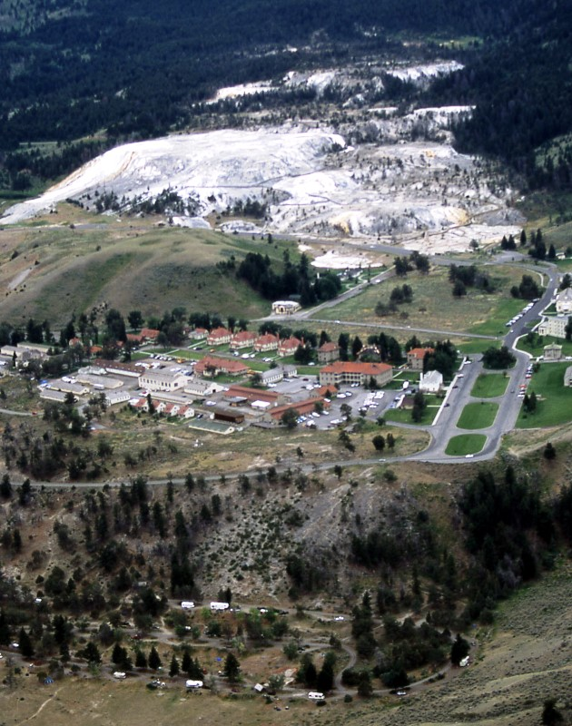 Aerial view of Mammoth Hot Springs with Fort Yellowstone, hotel/restaurant, and the travertine terraces. (Photo: Jim Peaco)