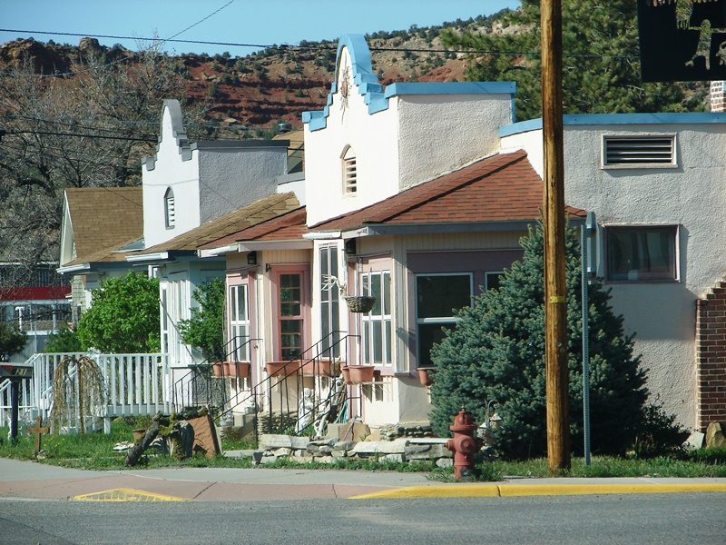 Houses, with a somewhat Spanish flair, sit quietly nestled in the mountains.