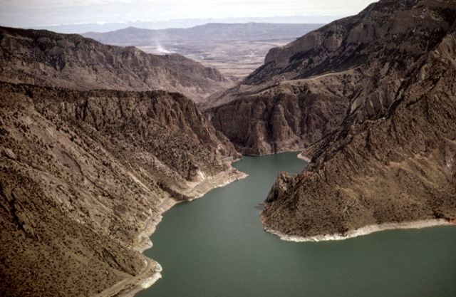 Aerial view - At Buffalo Bill Reservoir, looking east towards Cody, the highway follows the reservoir's shoreline right into the mountain where the tunnels are. (Photo: Louis J. Maher, Jr.)