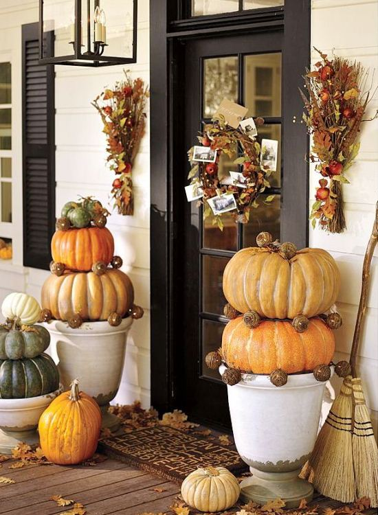 Giant pumpkins in footed urns. (Photo: Pottery Barn)