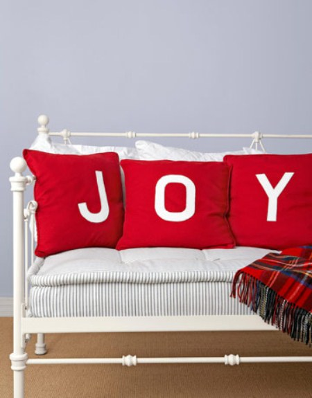 Appliqued Christmas pillows. (Photo: Country Living)