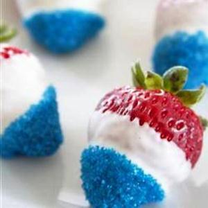 Strawberries in white chocolate and blue sparkles. (Photo: All Recipes)