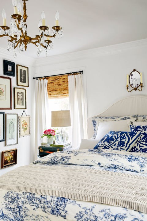 Janet created a floor-to-ceiling gallery wall in the bedroom.
