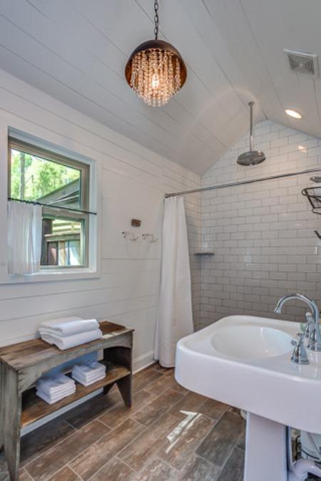 Light fixture in bathroom mimics the rain shower.