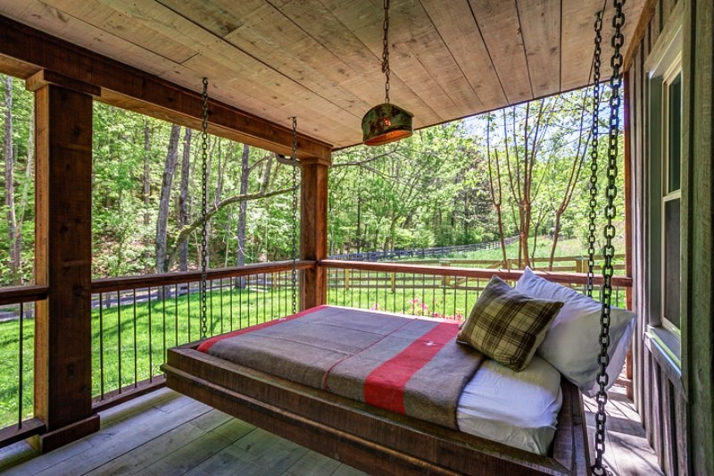 Front porch with swinging bed.