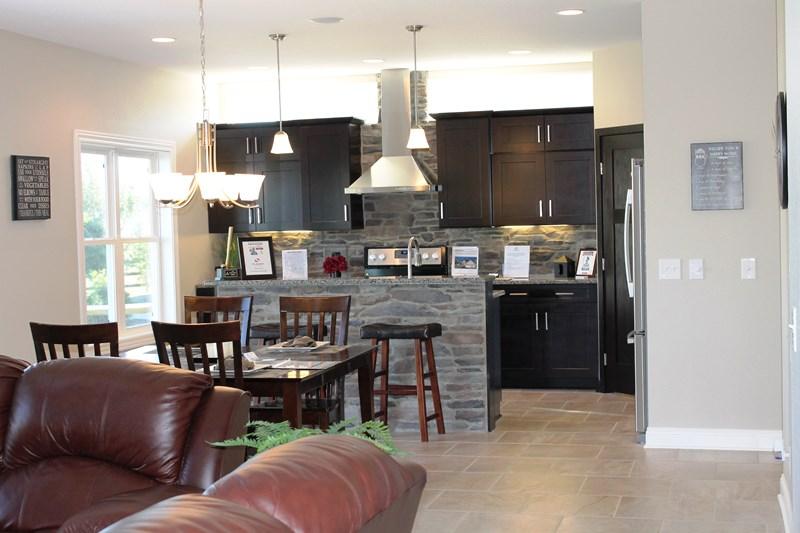 Kitchen with stone island and backsplash