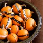 Beribboned Sugar Pumpkins. (Photo: James Baigrie/Good Housekeeping)