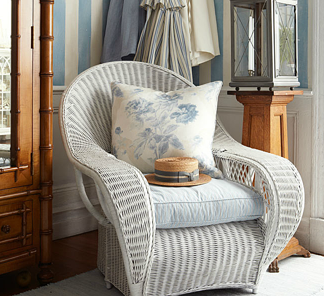 Conservatory Garden Wicker Lounge Chair with throw pillow in Summer Estate Floral-Cloud by Ralph Lauren.