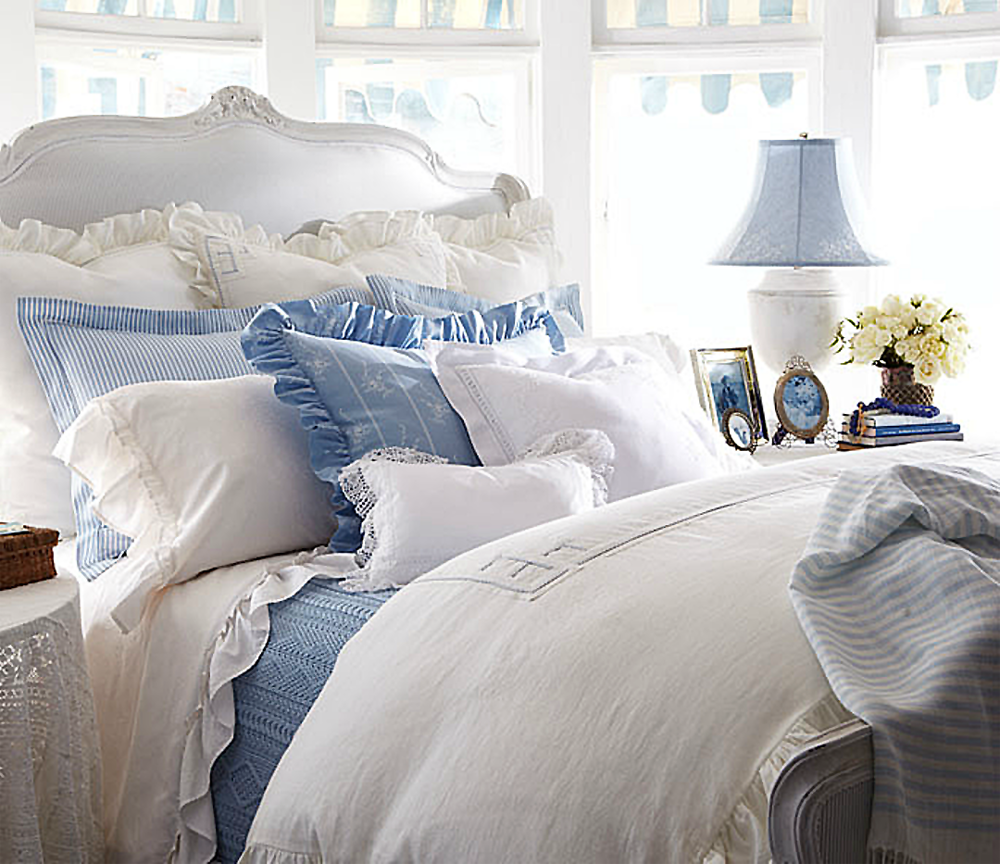 Mixed patterns and layers make for a luxurious bed.
