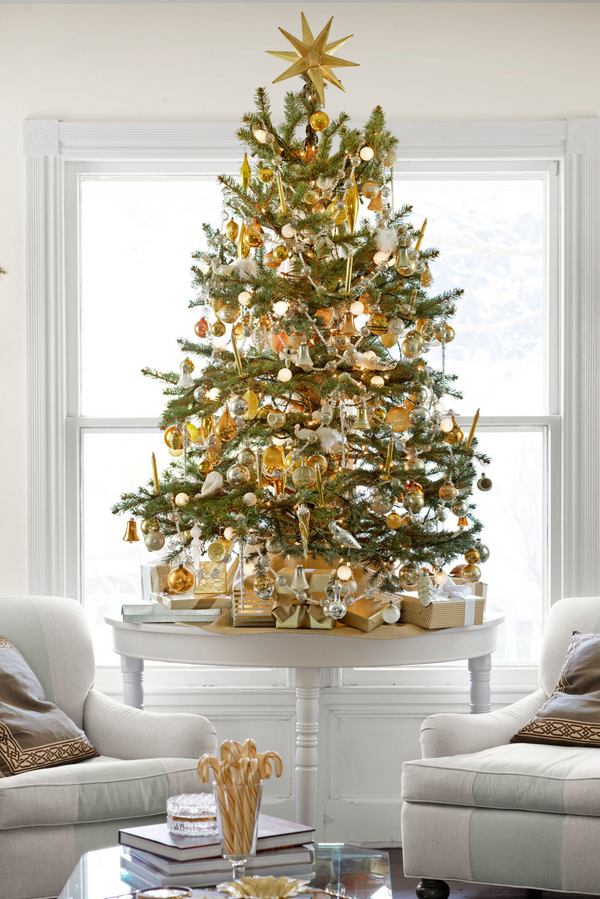 A mini tree in gold and white. (Photo: Country Living)
