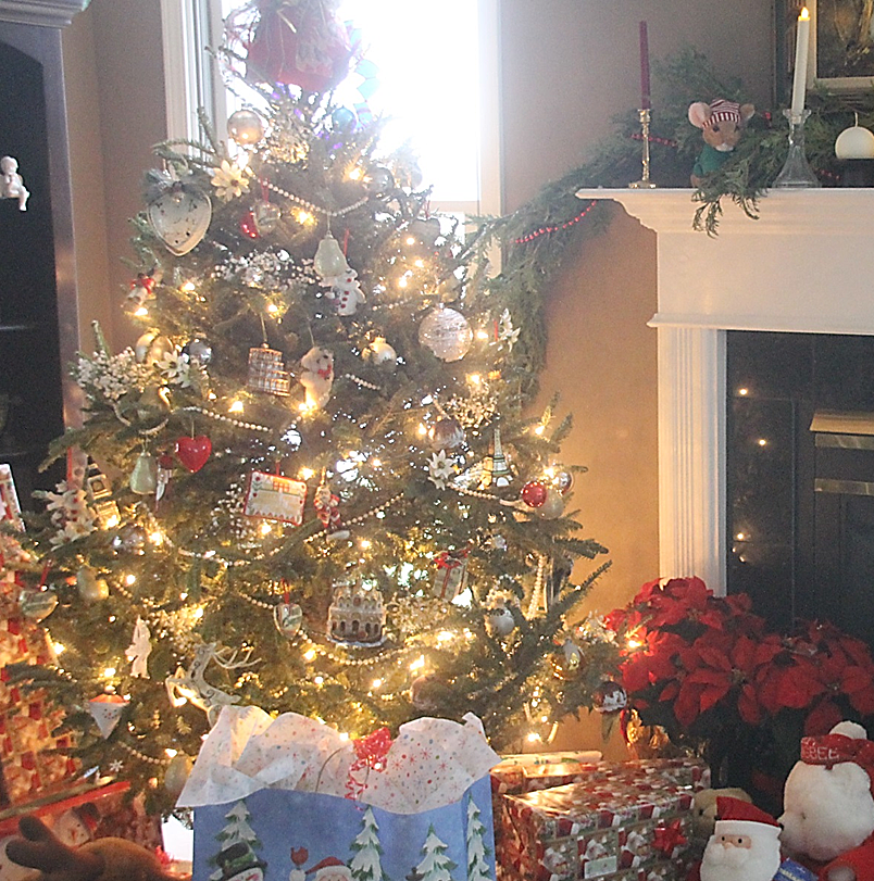 Our small tree with beads, bulbs, bears, babies breath, and ornaments collected through the years.