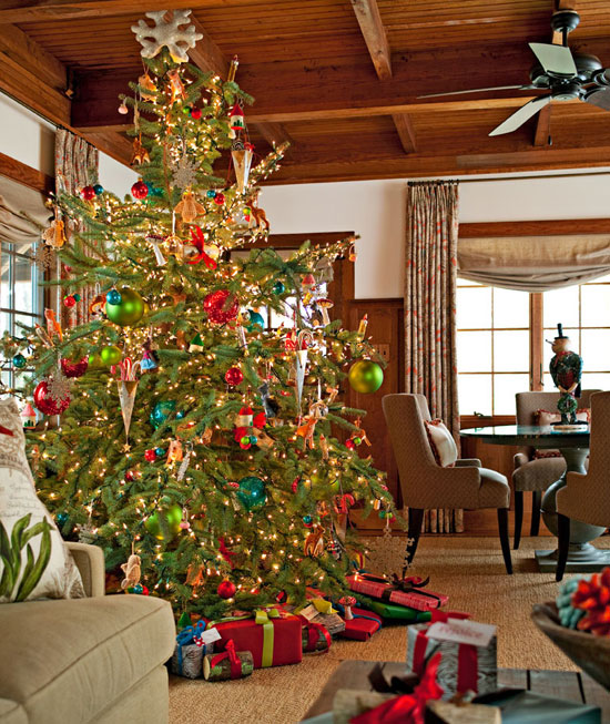 Traditional, glowing tree with oversized bulbs, vintage tin cones, and antique ornaments. (Photo: Traditional Home)