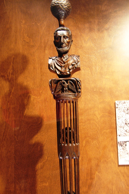 Lincoln cane with hand-carved ball in the center.