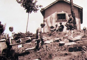 Ernest Warther hauling stone for the steps up to his workshop. (Photo: Warther Museum)