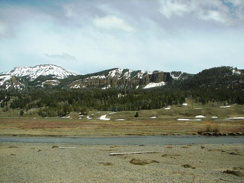 The road follows Soda Butte Creek along the Lamar Valley.