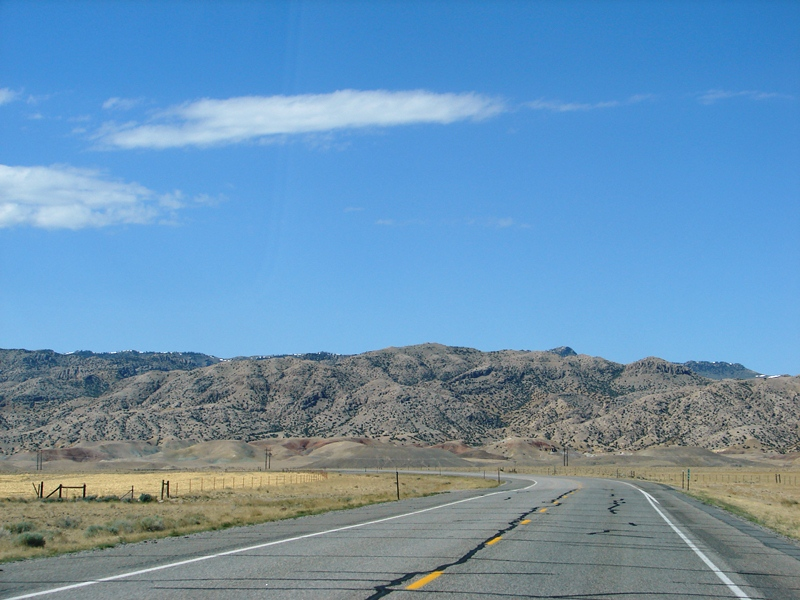 The long road winds towards the Owl Creek Mountains.