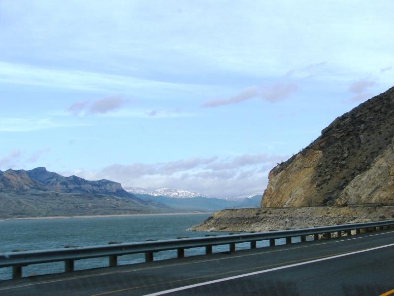 Buffalo Bill Reservoir, Sheep Mountain, and the snow-capped Absaroka Range beyond.