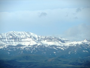Closeup of the distant, snow-capped Absaroka Range on a clear day in mid-May.