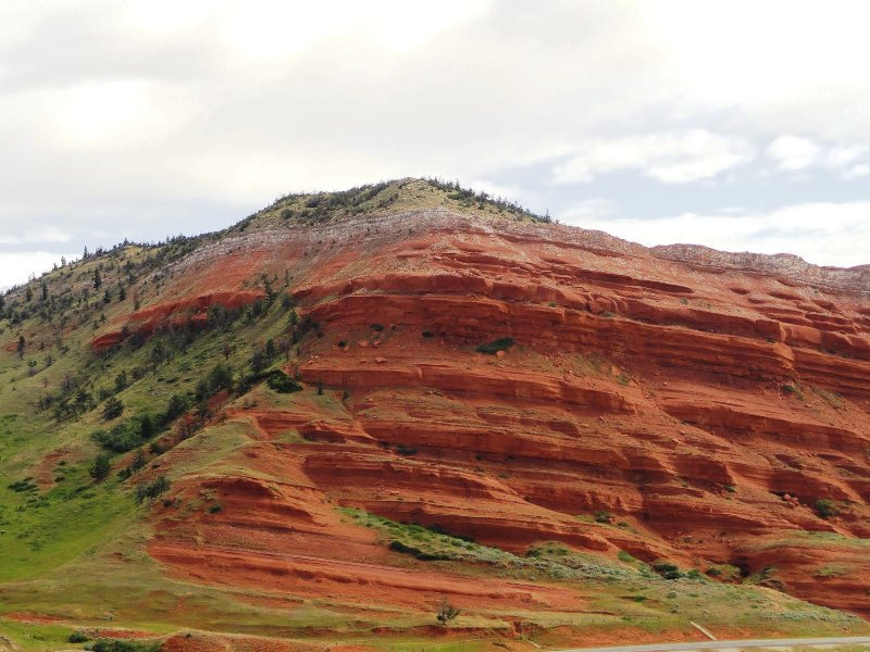 The red rock contrasts dramatically with the greenery.