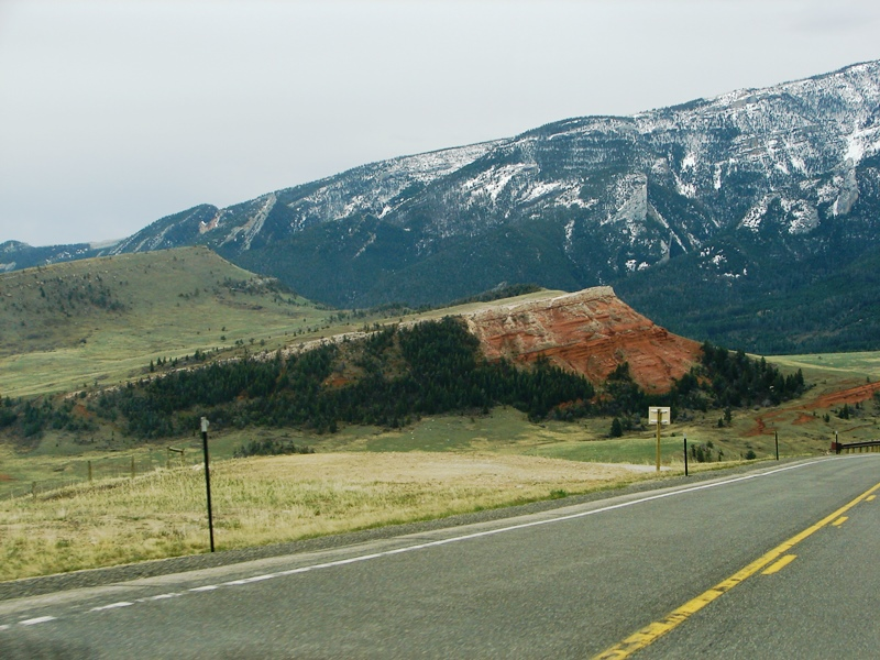 The Chugwater Formation is stunning against a soft pallet of green and the cool hues of the landscape.