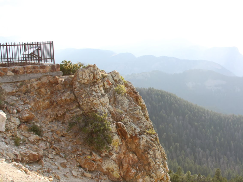 Rugged rock and a plunging cliff at Dead Indian Summit Overlook.