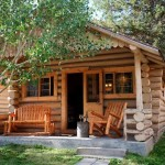 Front porch of this cabin provides a comfortable place to sit.